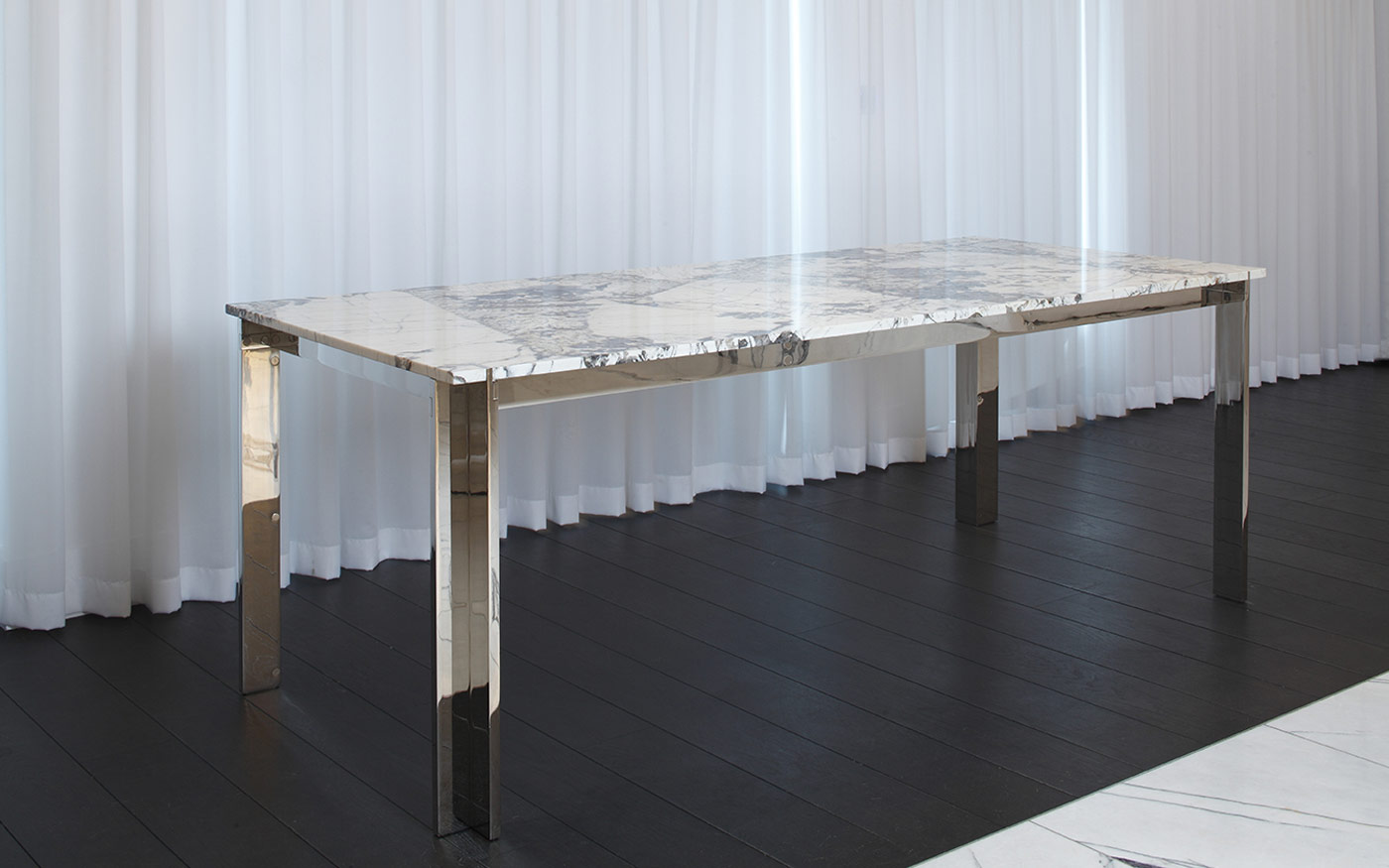Nickel plated dining table with Patagonia Quartzite table top, photographed in the penthouse suite at the Mandrake Hotel