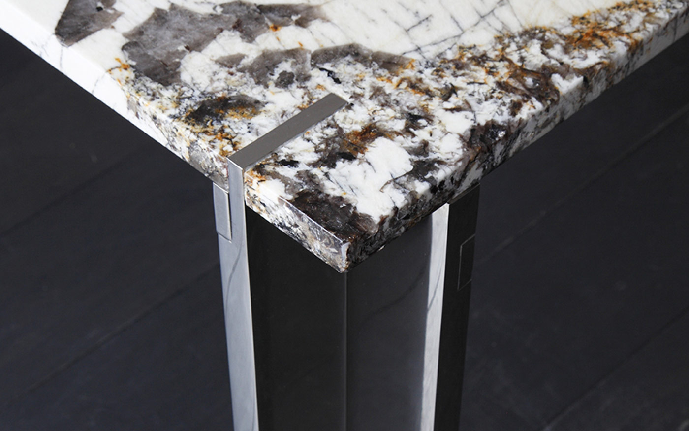 Corner detail of Nickel plated dining table with Patagonia Quartzite top