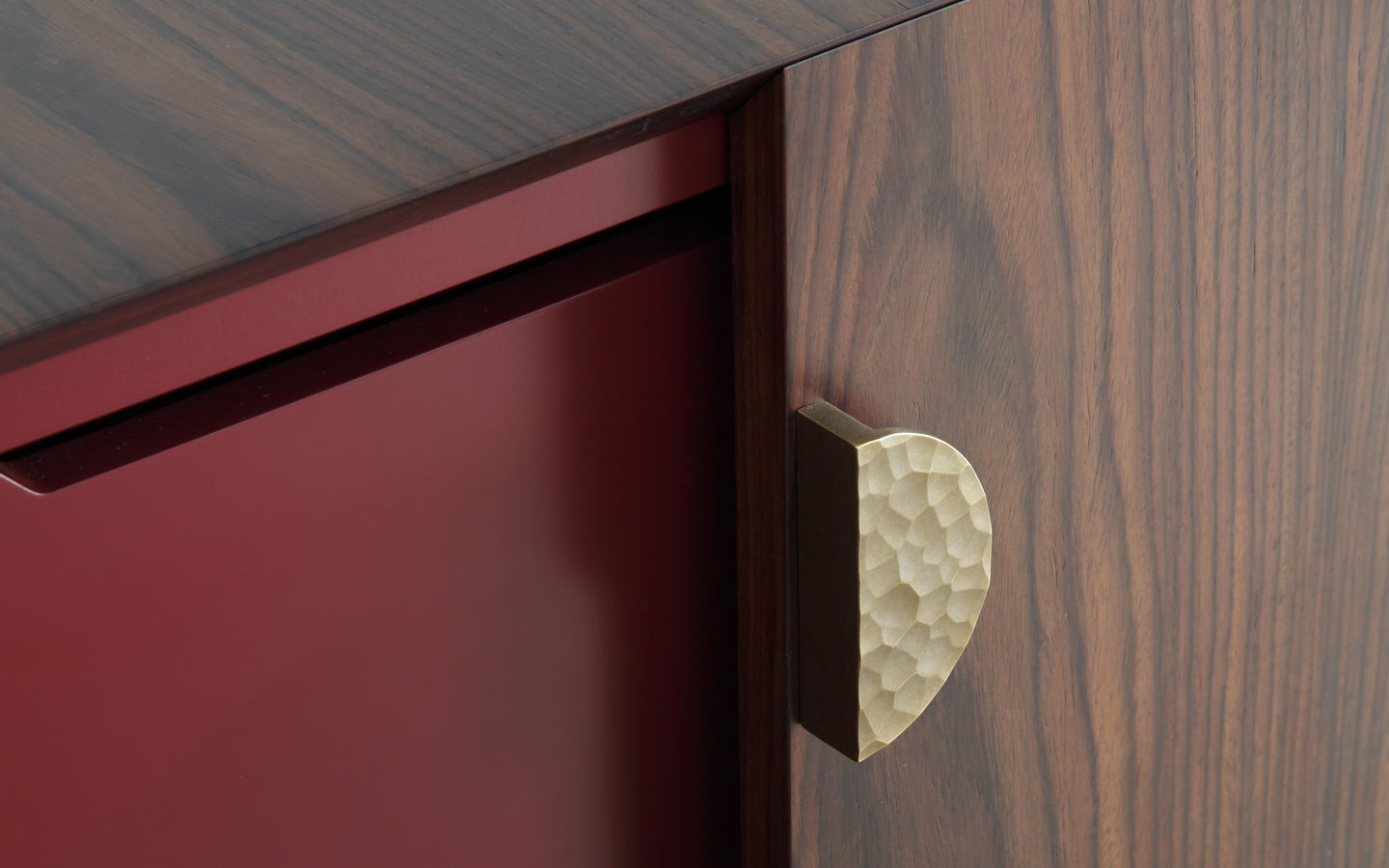 Detail of Mies cabinet with mitred doors and mitred top with hammered brass handle
